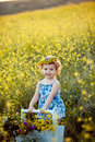 Happy childhood baby girl in wreath in field Stock Images