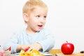 Happy childhood. Boy child kid eating peeled apple fruit. At home. Royalty Free Stock Photo