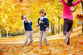 Happy children, boy brothers, playing in the park with leaves Royalty Free Stock Photo