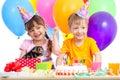 Happy children celebrating birthday party