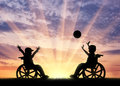 Happy children disabilities play ball sunset Royalty Free Stock Photo