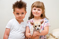 Happy children with a dog Royalty Free Stock Photo