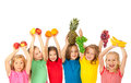 Happy children with fruits Royalty Free Stock Photo