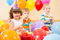 Happy children with gifts on birthday party Royalty Free Stock Photo