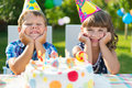 Happy children having fun at birthday party two Stock Photo