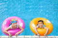 Happy children having fun in the swimming pool Stock Image