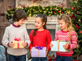 Happy children holding gift boxes Royalty Free Stock Photo
