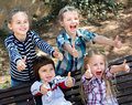 Happy  children holding hands and giving friendship Royalty Free Stock Photo