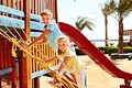 Happy children move out to slide playground Royalty Free Stock Images