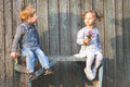 Happy children outdoor at fall season, sitting at bench. First date Royalty Free Stock Photo