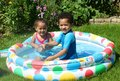 Happy children in paddling pool Royalty Free Stock Photography