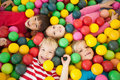 Happy children playing in ball pool Royalty Free Stock Photo