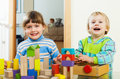 Happy children playing with blocks in home