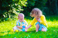 Happy children playing in the garden with toy balls Royalty Free Stock Photo