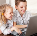Happy children playing laptop Royalty Free Stock Images