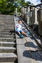 Happy children playing slipping from the edge of a stone stairca nara japan october staircase Royalty Free Stock Photo