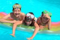 Happy children in pool a group of playing with an air mattress a swimming Stock Image