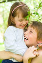 Happy children portrait of a child the love of brother and sister in his arms outdoors Royalty Free Stock Photography