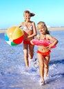 Children  running on  beach. Royalty Free Stock Photo