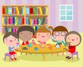 Happy children`s activity in the kindergarten, cute kids with playing toy, Group of happy school child in classroom, education