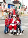 Happy children and santa claus full length of in courtyard Stock Image
