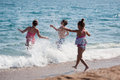 Happy children and sea having fun in the Royalty Free Stock Photos