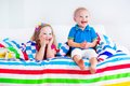 Happy children sleeping under colorful blanket Royalty Free Stock Photo