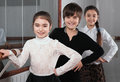 Happy children standing near ballet barre Royalty Free Stock Image