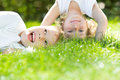 Happy children standing upside down green grass spring park healthy lifestyles concept Stock Images