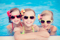 Happy children in the swimming pool funny kids playing outdoors summer vacation concept Royalty Free Stock Images