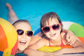 Happy children in the swimming pool funny kids playing outdoors summer vacation concept Royalty Free Stock Photos