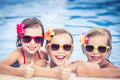Happy children in the swimming pool showing thumbs up funny kids playing outdoors summer vacation concept Royalty Free Stock Photos