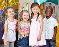 Happy children together in a kids interracial group kindergarten Royalty Free Stock Photos