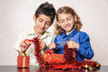 Happy children working at christmas present decorations very smiling homemade and Stock Image