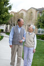 Happy Chinese Elderly Couple Walking Royalty Free Stock Photography
