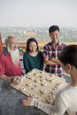 Happy chinese family playing chinese chess xiang qi Stock Photography