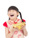 Happy  chinese new year. little girl showing  gold Royalty Free Stock Photo