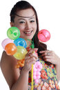 Happy chinese woman smiling through a balloon Royalty Free Stock Images