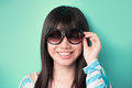 Happy Chinese woman wearing  sunglasses Stock Images