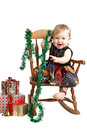 Happy Christmas baby rocks in patchwork dress Royalty Free Stock Image