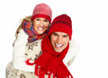 Happy christmas couple in winter clothing isolated over white background Stock Images