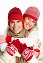 Happy christmas couple in winter clothing isolated over white background Royalty Free Stock Photos