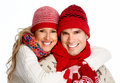 Happy christmas couple in winter clothing isolated over white background Royalty Free Stock Photo