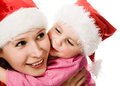Happy Christmas daughter kissing mother Stock Photography