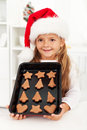 Happy christmas girl baking cookies Stock Images
