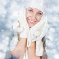 Happy christmas girl wearing white knitted hat and gloves beautiful young caucasian woman looking at camera smiling posing among Royalty Free Stock Photography