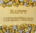 Happy Christmas golden text and Christmas decorations Royalty Free Stock Photo