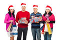 Happy Christmas people holding gifts Stock Photography