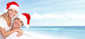 Happy christmas santa couple on the beach holidays Royalty Free Stock Photos