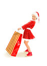 Happy christmas shopping little girl dressed as santa with gift bag Royalty Free Stock Images